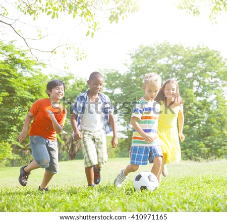 Children playing Football at park. - stock photo