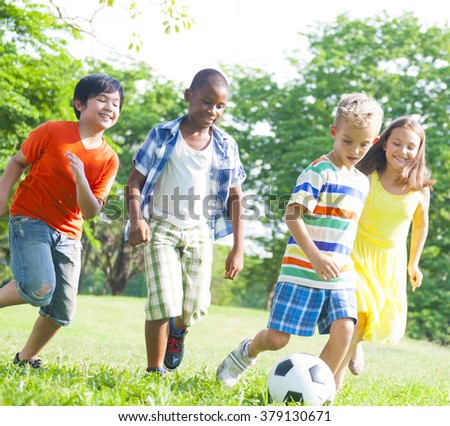 Children Playing Football Holidays Summer Concept - stock photo