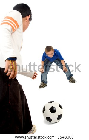 children playing football over a white background - stock photo