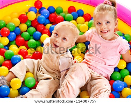Children playing in colored ball.