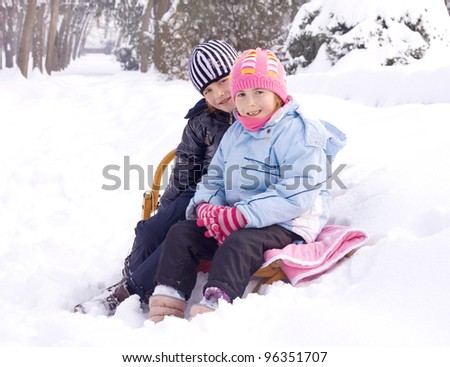 children playing in snow - stock photo