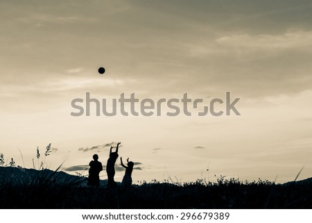 Children playing in sunset, silhouette, freedom and happiness