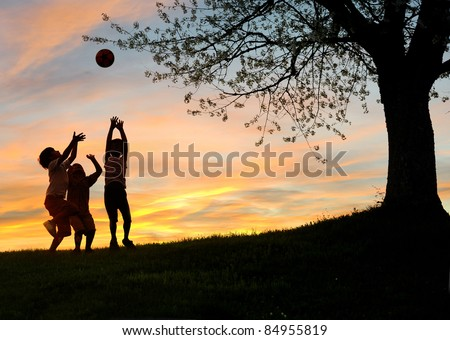 Children playing in sunset, silhouettes, freedom and happiness - stock photo