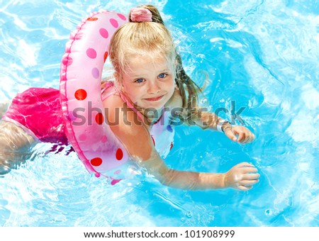 Children playing in swimming pool. Summer outdoor.