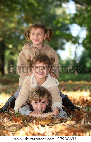 Children playing in the park - stock photo
