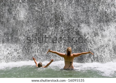 Children playing in waterfall - stock photo