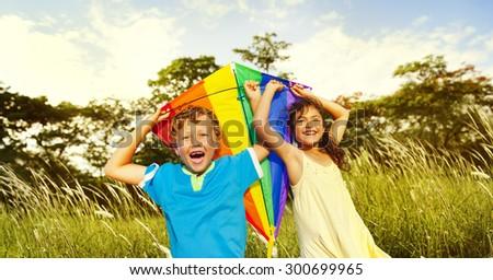 Children Playing Kite Happiness Cheerful Beach Summer Concept - stock photo