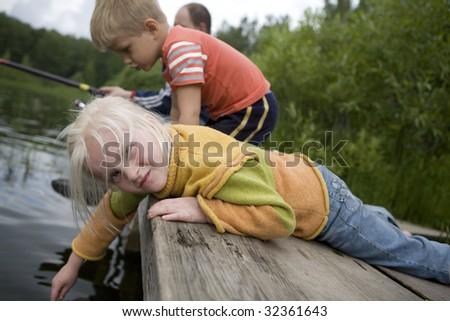 children playing near river - stock photo