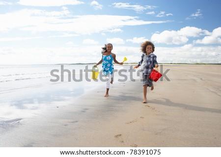 Children playing on beach - stock photo