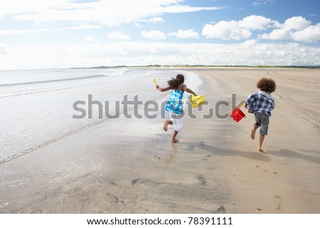 Children playing on beach - stock photo