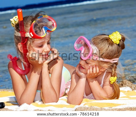 Children playing on beach. - stock photo
