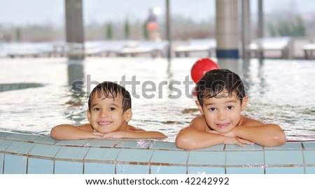 Children playing on beautiful pool - stock photo