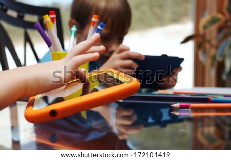 Children playing on digital tablet at home - stock photo