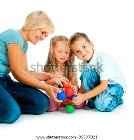 Children playing on the floor. Educational games for kids - stock photo