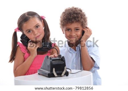 Children playing on the phone