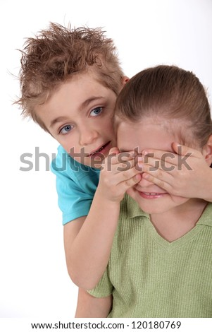 Children playing peekaboo - stock photo