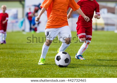 Children playing soccer football match. Running players and kicking soccer ball. Sport school tournament for youth soccer teams. Youth soccer football background - stock photo