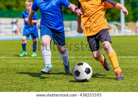 Children Playing Soccer Football Match. Sport Soccer Tournament for Youth Teams. - stock photo