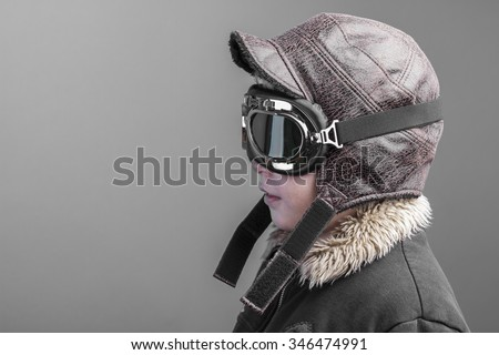 children playing the aircraft pilot with hat and retro bomber jacket - stock photo