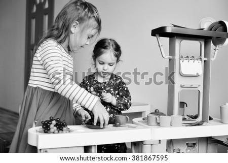 children  playing toy kitchen in the kindergarten - stock photo
