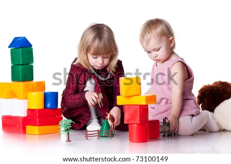 Children playing with blocks isolated on white - stock photo