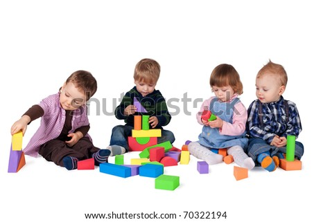 children playing with cubes - stock photo