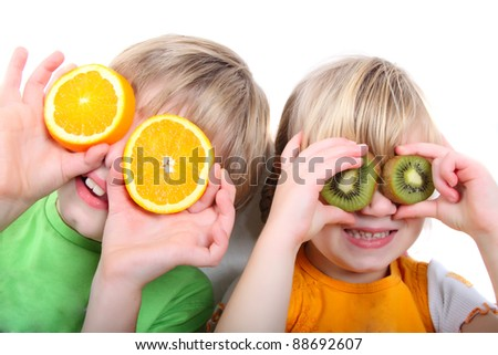 children playing with fruit - stock photo