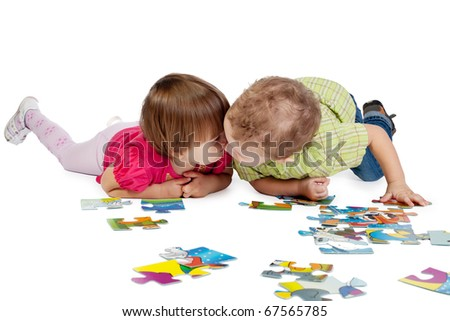children playing with puzzles - stock photo