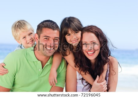 Children playing with their parents - stock photo