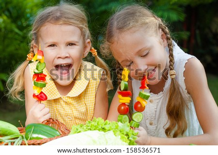 children playing with vegetables - stock photo