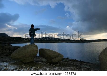 Children pointing the horizon - stock photo