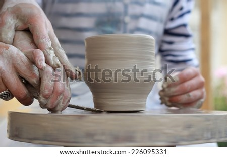 Children Potter's hands creating new cup/ Children Potter's hands creating new cup - stock photo