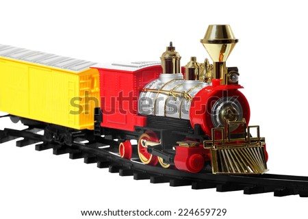 Children railroad - toy vintage steam locomotive on rails isolated on white background - stock photo