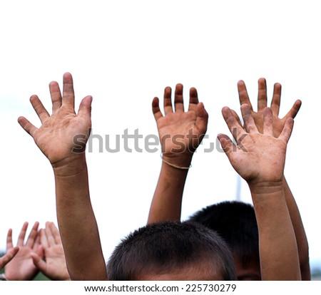 Children Raising hands. - stock photo