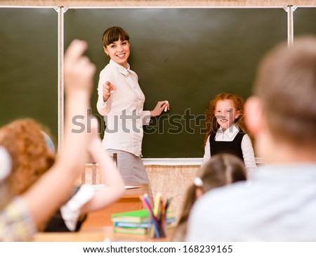 Children raising hands knowing the answer to the question - stock photo