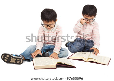 children reading  book on the floor and isolated on white - stock photo