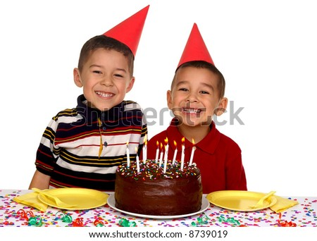 Children ready to enjoy a birthday cake - stock photo