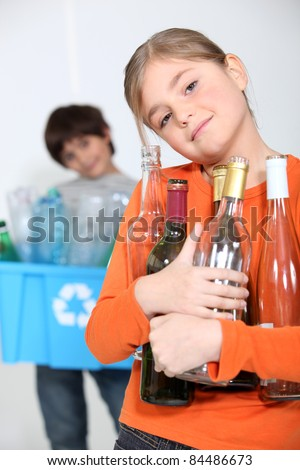 Children recycling glass bottles - stock photo