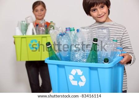 Children recycling plastic bottles - stock photo