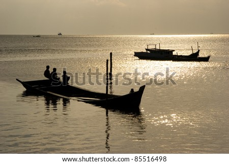 Children resting on a boat during sunset