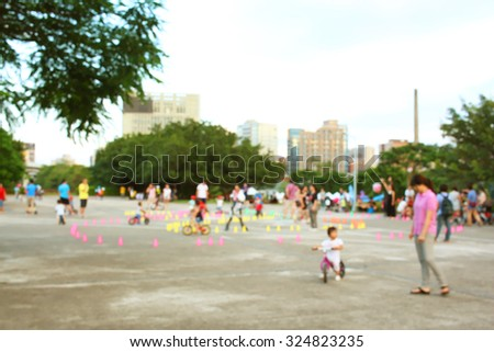 Children riding bicycles in park - stock photo