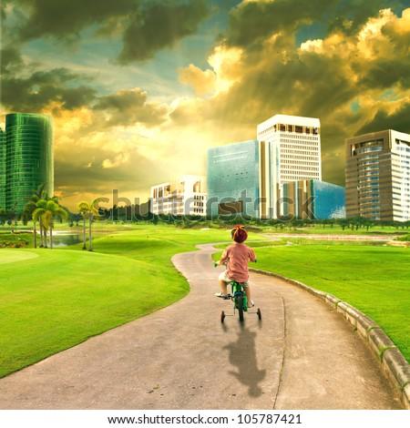 Children riding bikes into town - stock photo