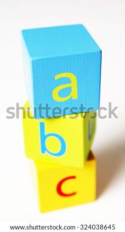 Children's Alphabet Blocks On White Background - stock photo