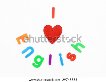 Children's alphabet letters and a heart are used to spell 'I love English'.  It's a reference to learning English as a first or second language - stock photo