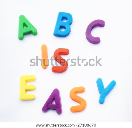 Children's alphabet letters are used to spell 'ABC is EASY'.  This is a reference to learning made easy.  It could be learning English or any subject. - stock photo