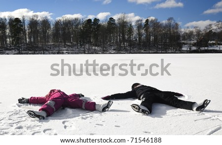 Children's angel sings on the snowy lake - stock photo