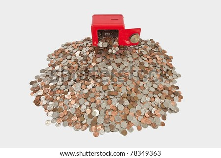 Children's bank with giant pile of coins. - stock photo