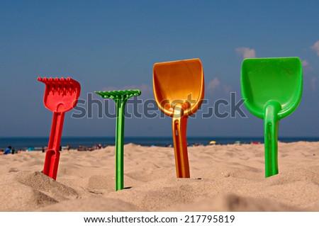 Children's beach toys at the beach - stock photo