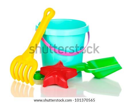 Children's beach toys isolated on white - stock photo