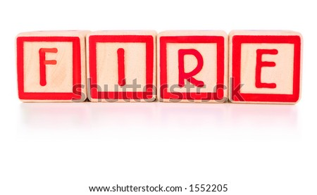 Children's bright red building blocks spelling the work fire - stock photo